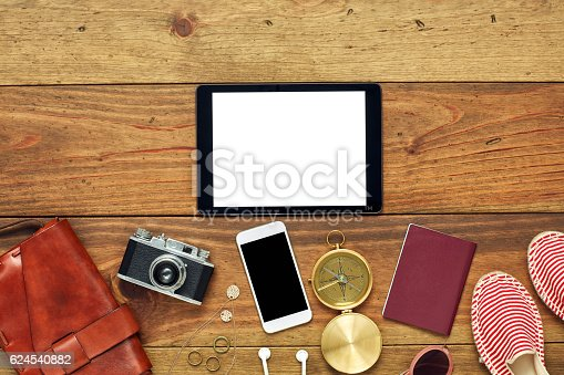 941183588 istock photo Tablet computer by beach accessories flat lay on floor 624540882