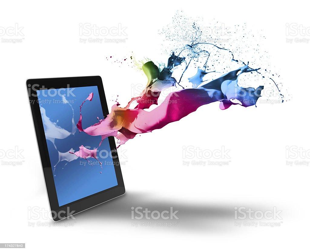 Tablet computer color splash stock photo