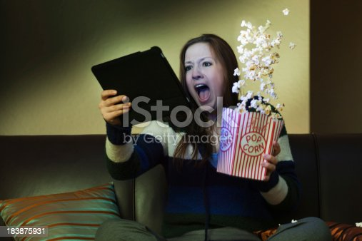 istock Tablet Computer Entertainment, Watching Scary Movie Screaming with Popcorn 183875931