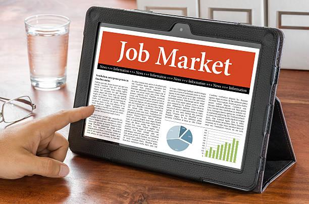 Tablet computer on a desk - Job Market stock photo