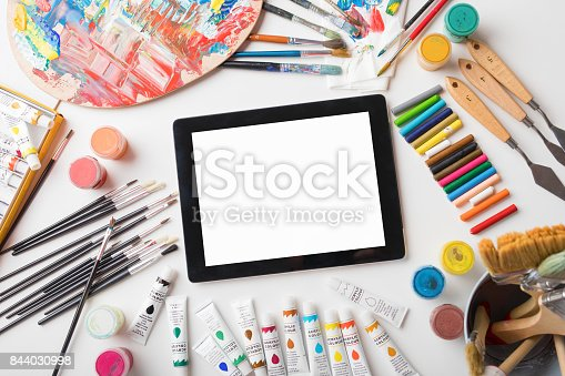 istock Tablet computer on artists table 844030998
