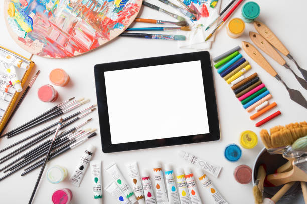 Tablet computer on artists table stock photo