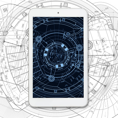 istock Tablet computer over architectural blueprints on white background 586047320