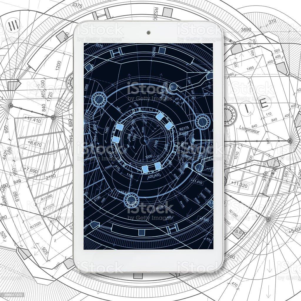 Tablet computer over architectural blueprints on white background - foto de stock