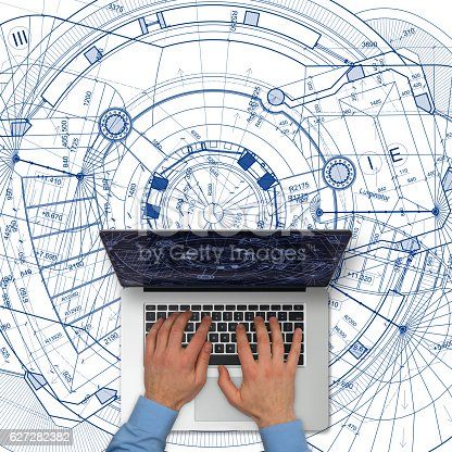istock Tablet computer over architectural blueprints on white background 627282382