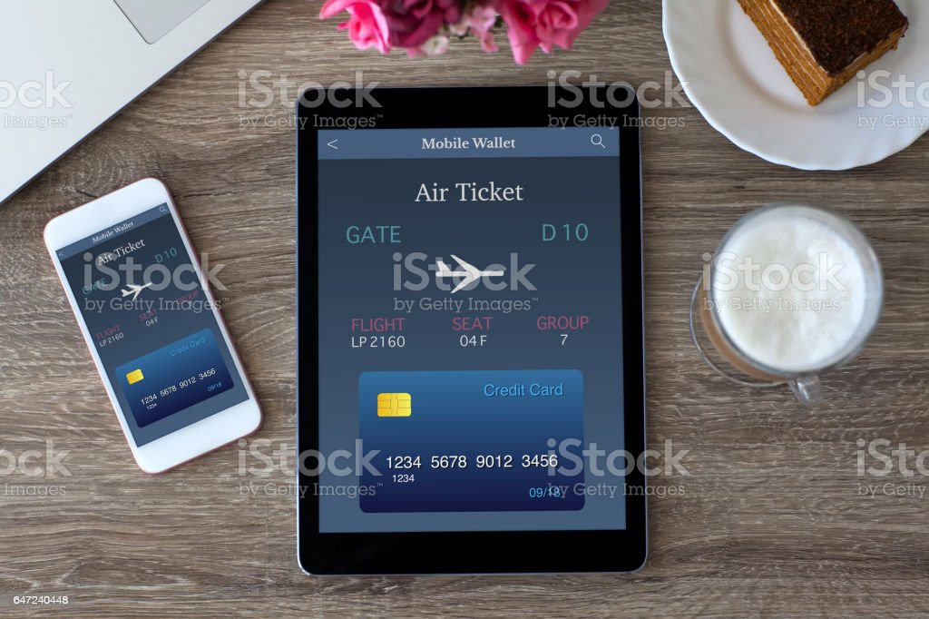 tablet computer PC and touch phone air ticket on screen stock photo