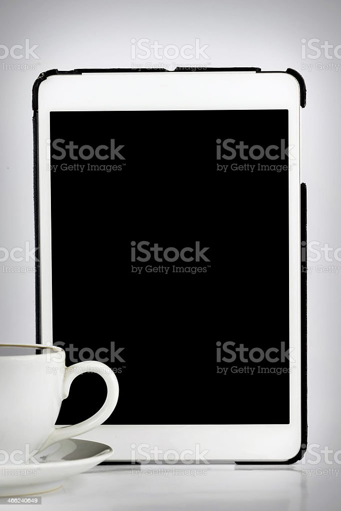 Tablet computer with cup of coffee isolated on white royalty-free stock photo