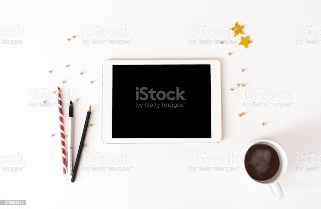 tablet display on table Christmas composition background. wallpaper, pine cones, decoration balls, on whit stock photo