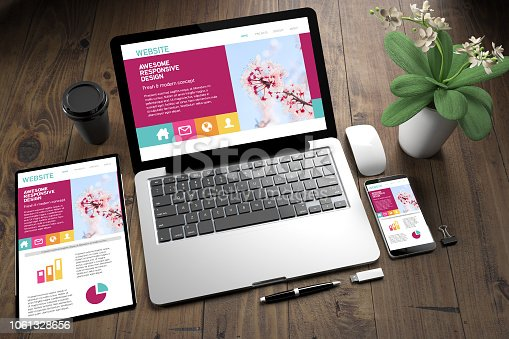 istock tablet, laptop and mobile phone over wooden desktop showing responsive website 1061328656