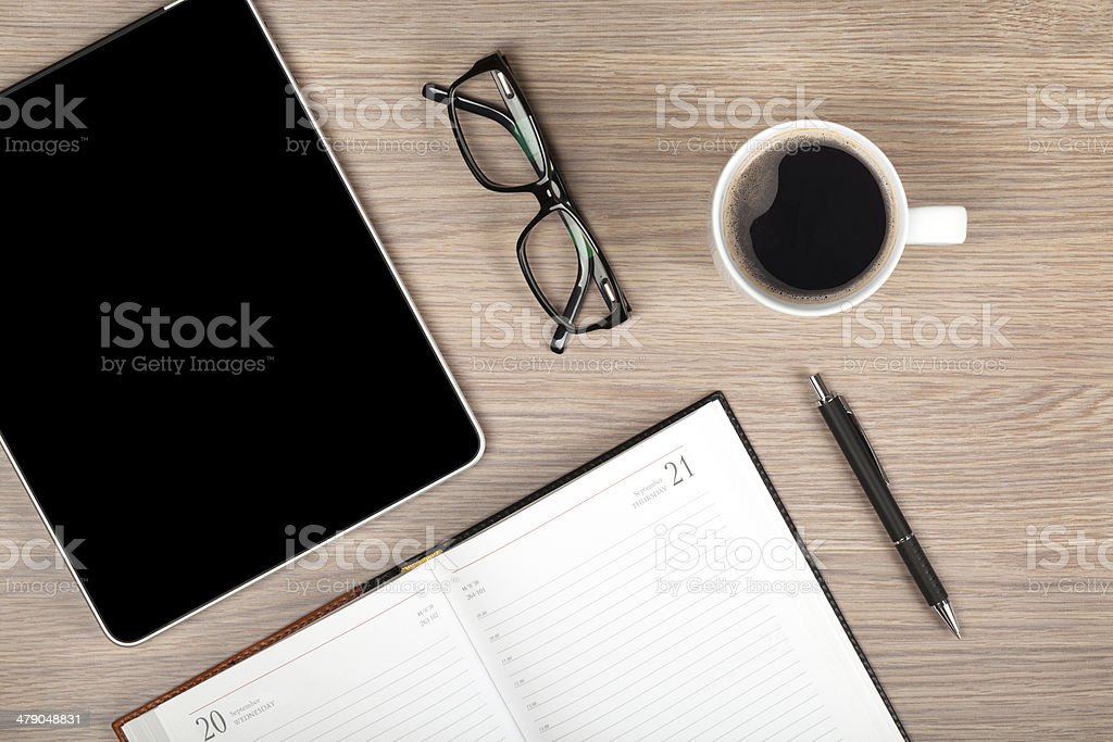 Tablet, notepad, glasses and coffee cup stock photo