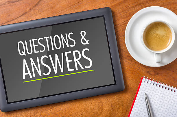 Tablet on a desk - Questions and Answers stock photo
