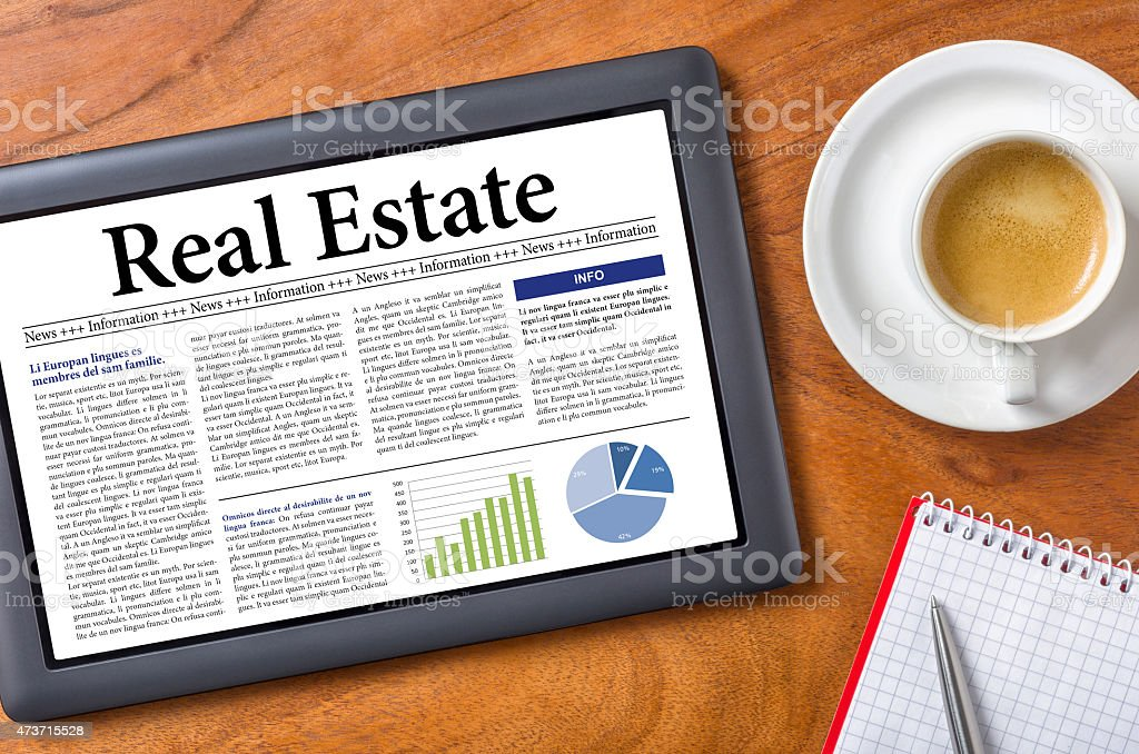 Tablet on a desk - Real Estate stock photo