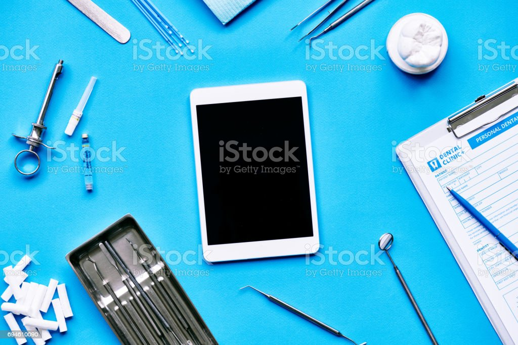 Tablet on dentists table stock photo
