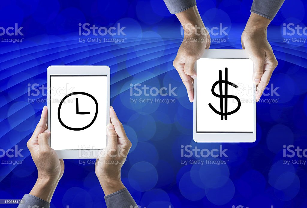 Tablet on hand with time and money sign royalty-free stock photo