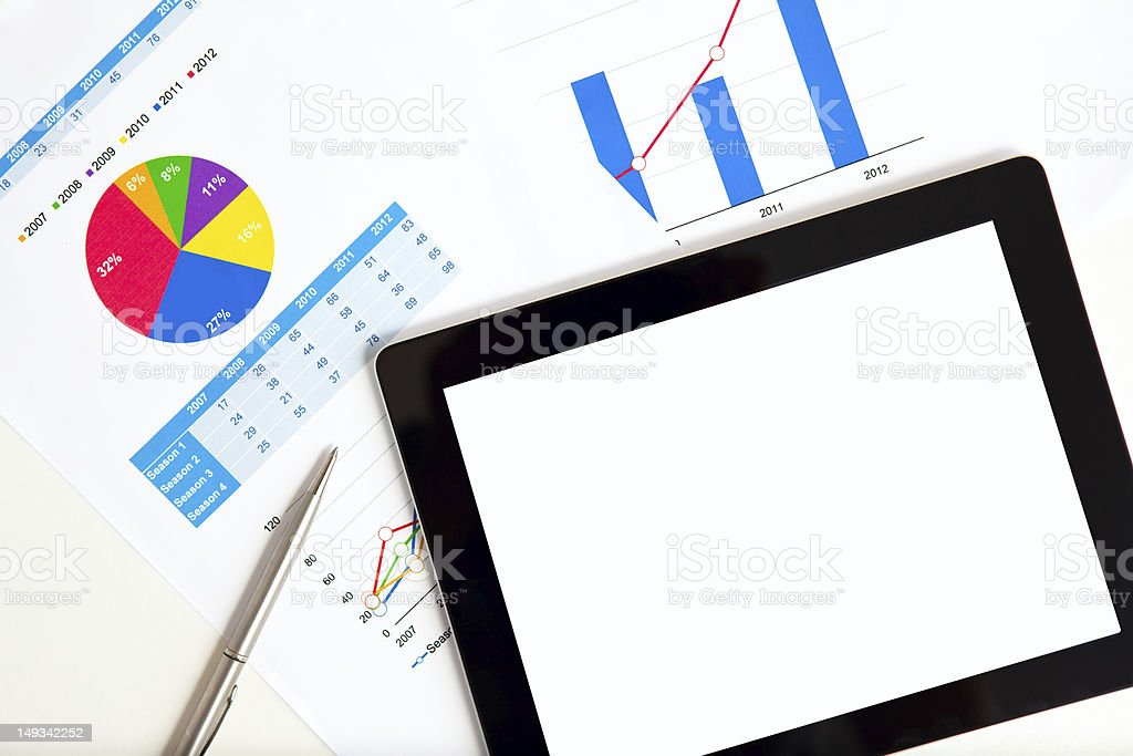 tablet on the table of graphs royalty-free stock photo