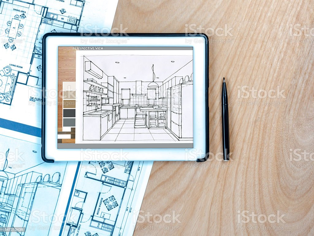 Tablet on wooden worktable with blue print/ business background stock photo