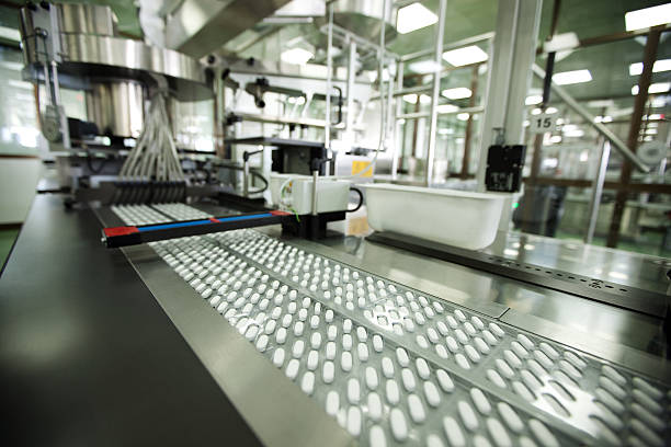 tablet packing in pharmaceutical company stock photo