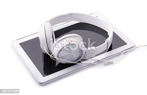 Tablet PC and headphones isolated on white