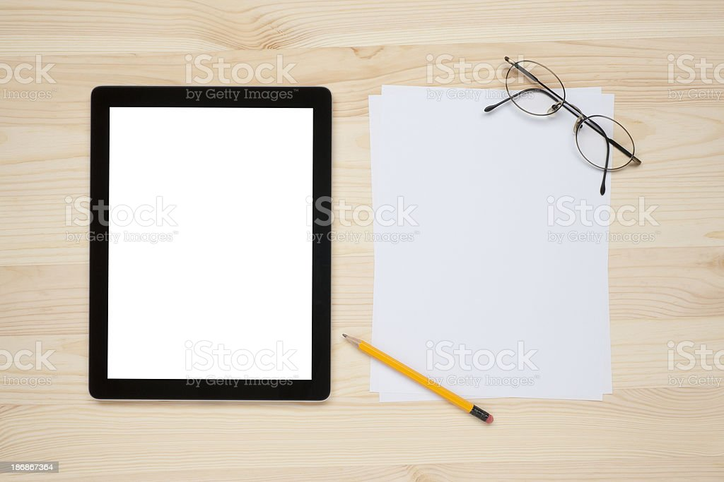 Tablet PC on a worktable royalty-free stock photo