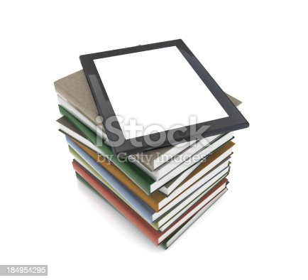 istock Tablet PC on Books 184954295