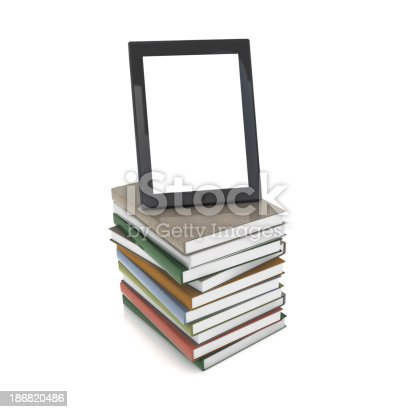 istock Tablet PC on Books 186820486