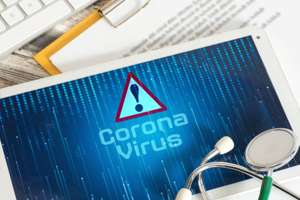Tablet PC, Stethoscope and Corona Virus stock photo