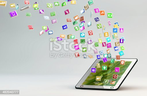 istock Tablet PC with cloud of application icons 452040777