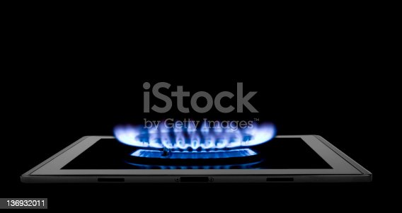 tablet computer and gas  on the black backgrounds