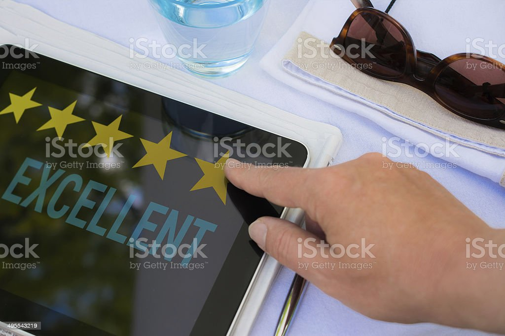 Tablet Rating 5 stars stock photo