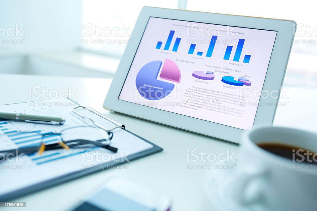 Tablet sitting on desk with document pulled up royalty-free stock photo