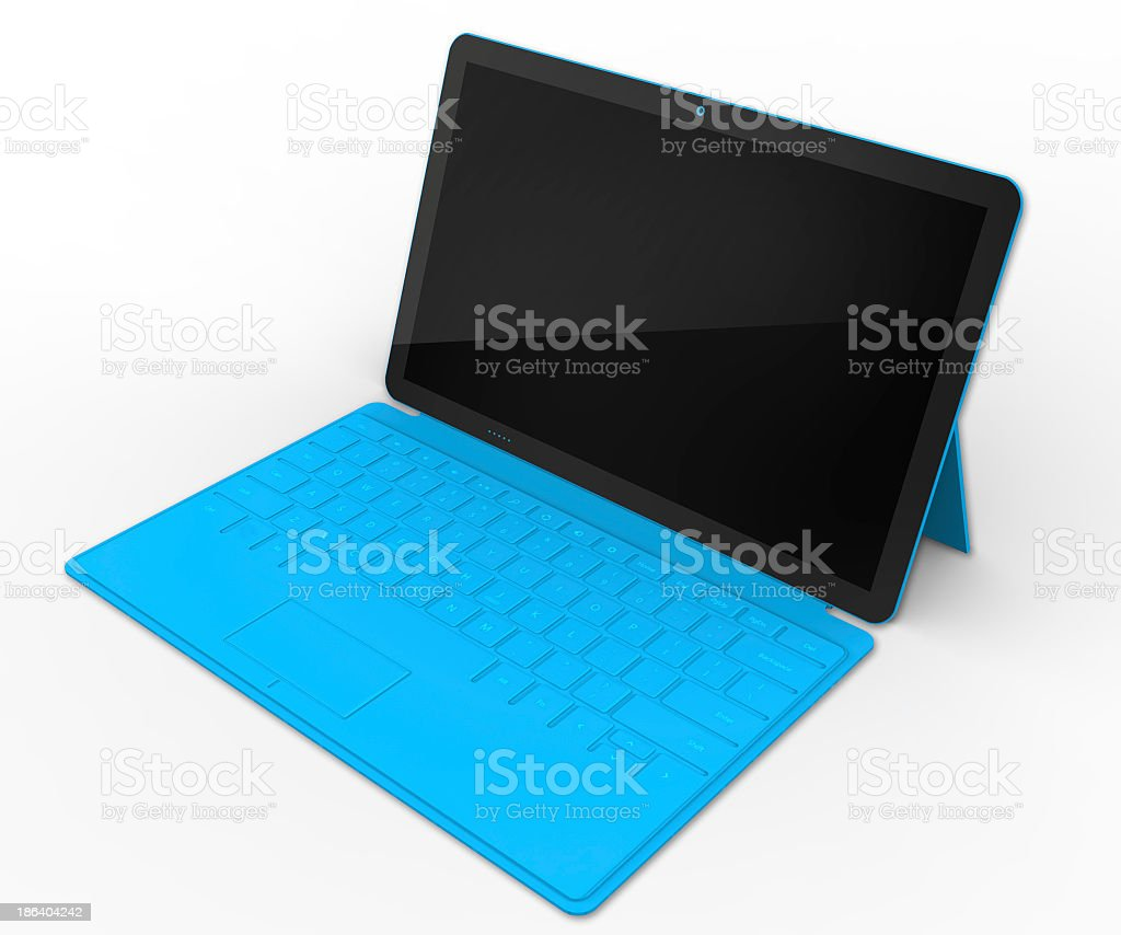 A tablet that is powered off and attached to a blue keyboard stock photo