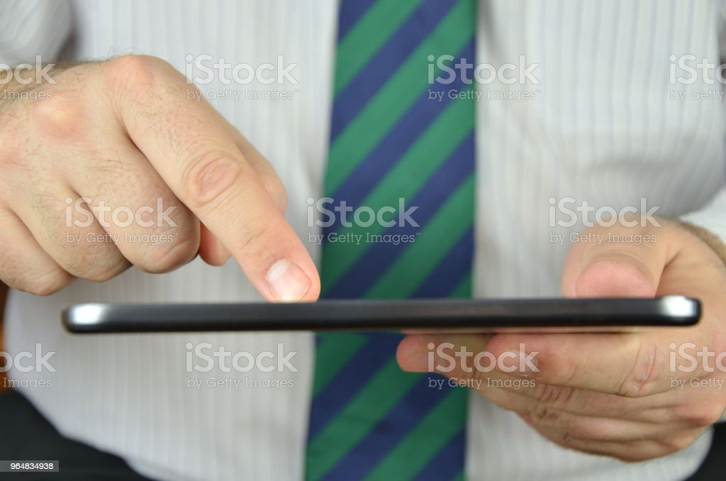 Tablet used by a businessman royalty-free stock photo