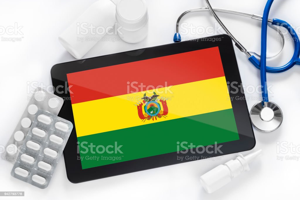 A tablet with a flag on its screen on a doctor's table stock photo