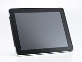 Generic Tablet Computer with Blank Screen isolated on White Background. Real Shadow. Angle View with Copy Space for Text or Image