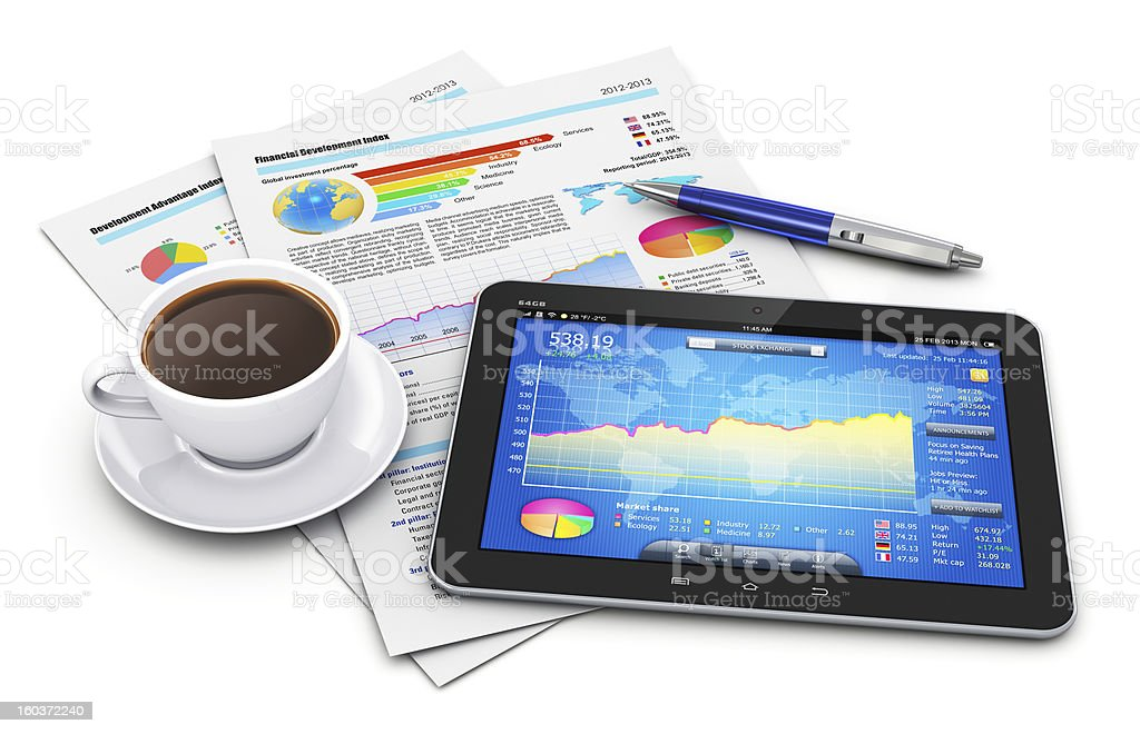 A tablet with charts and paperwork, coffee, and a pen royalty-free stock photo
