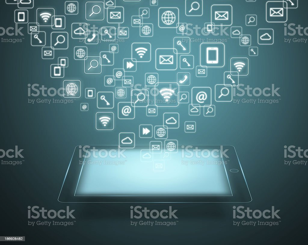 Tablet with cloud of application icons stock photo