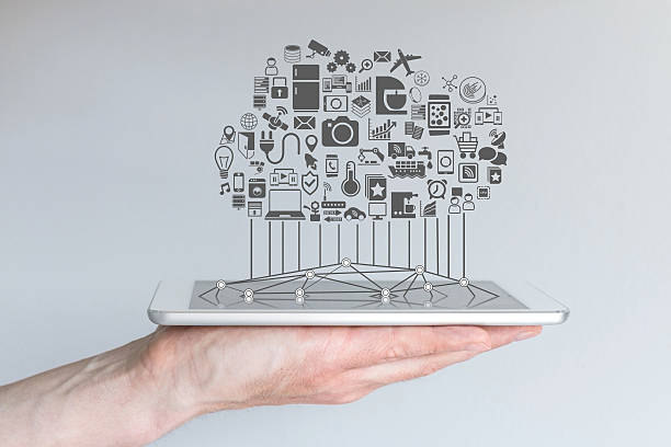 Tablet with cloud of connected devices for internet of things stock photo