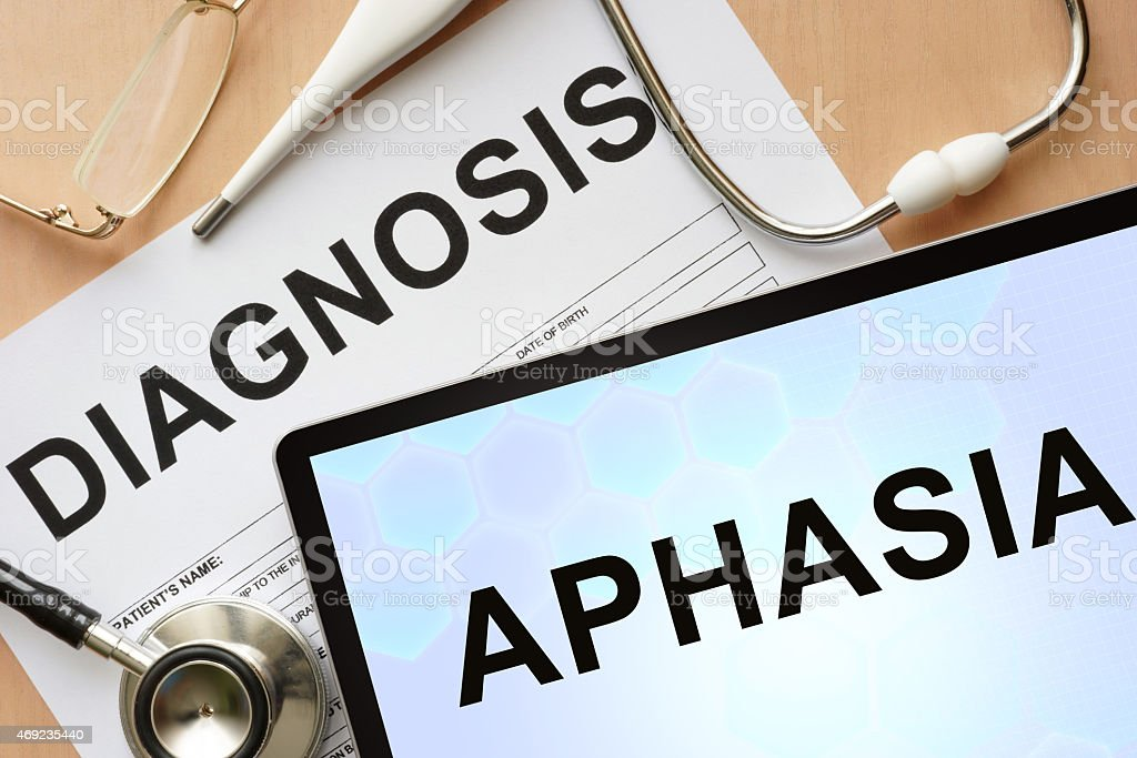 Tablet with diagnosis Aphasia and stethoscope. stock photo