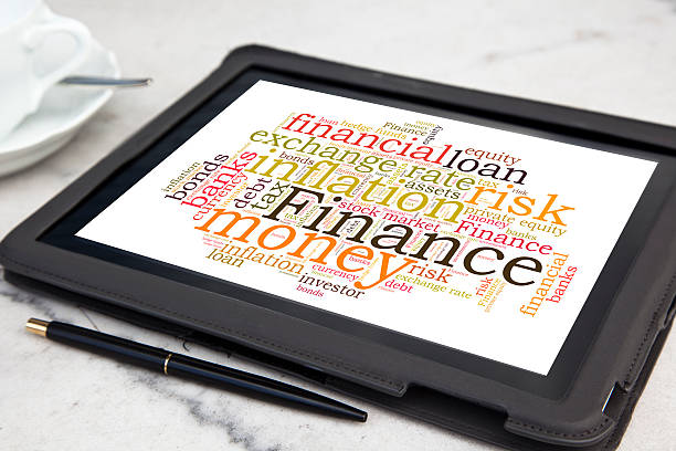 tablet with finance word cloud stock photo