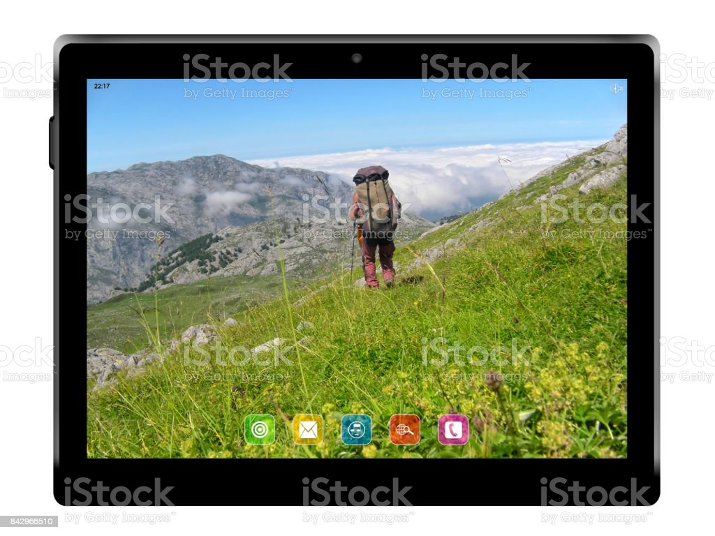 Tablet with hotography of mountains. stock photo