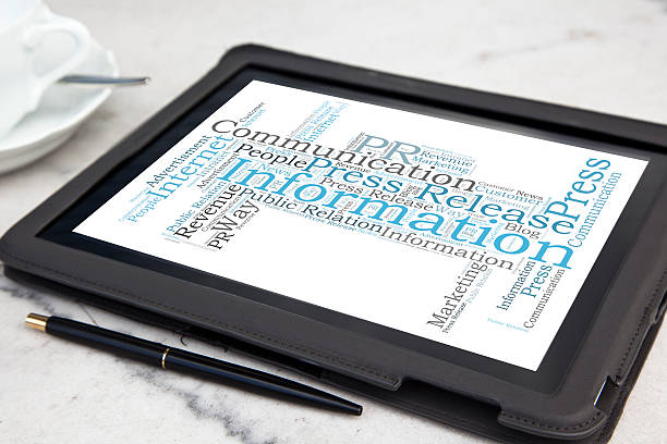 tablet with public relation word cloud stock photo