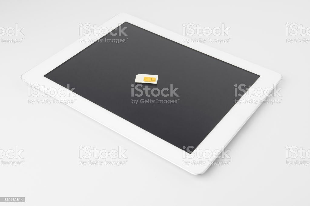 Tablet With Smartphone Sim Card stock photo