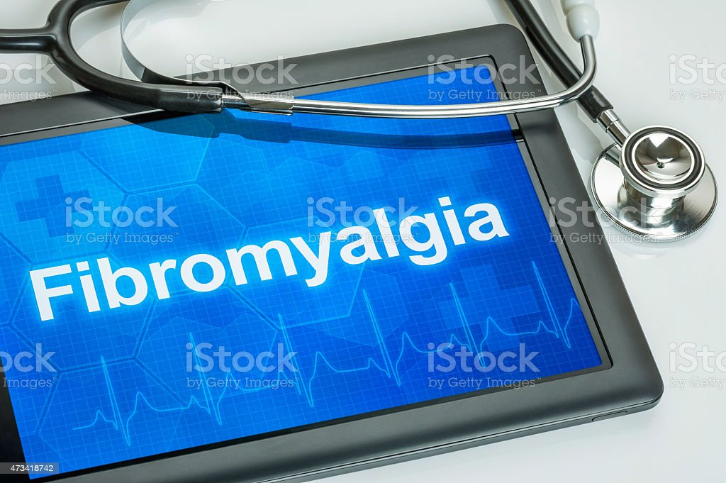 Tablet with the diagnosis Fibromyalgia on the display stock photo