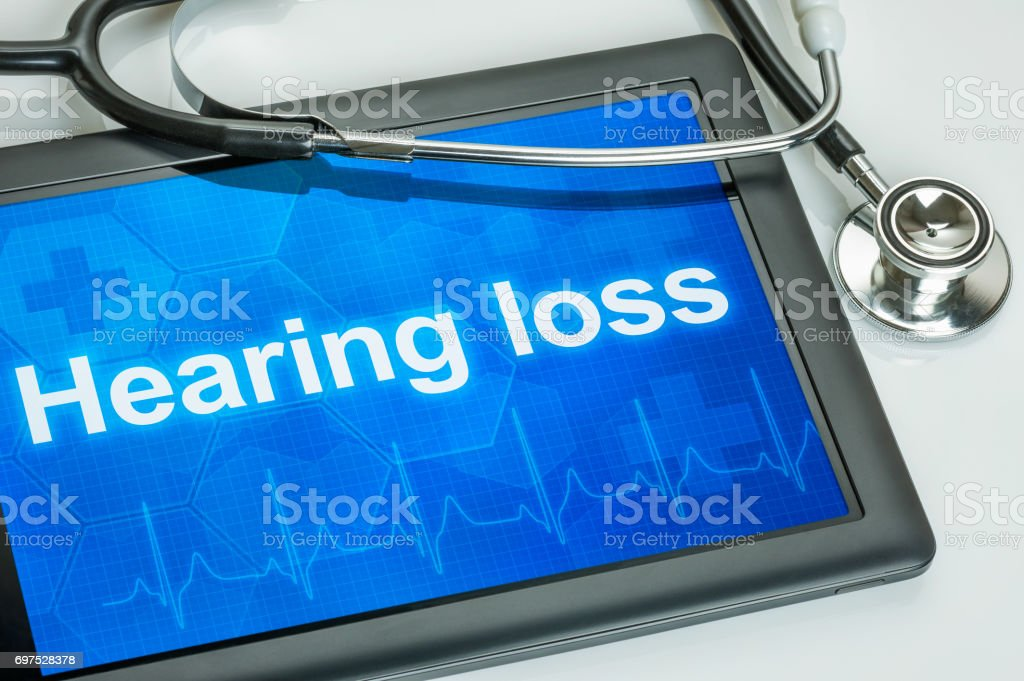 Tablet with the diagnosis Hearing loss on the display stock photo