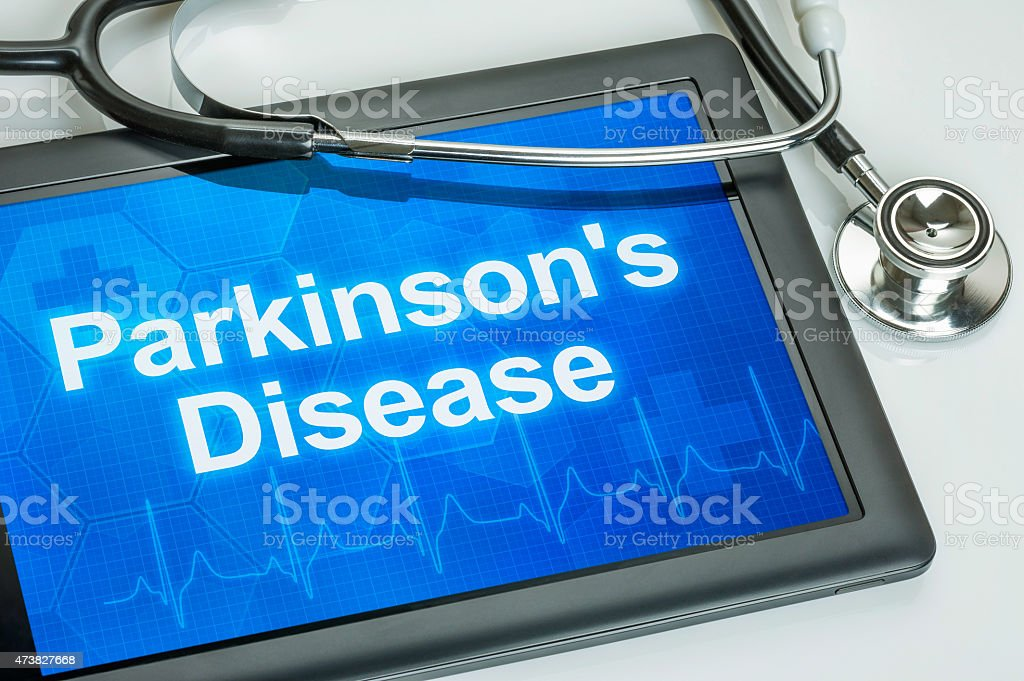 Tablet with the diagnosis parkinson's disease on the display stock photo