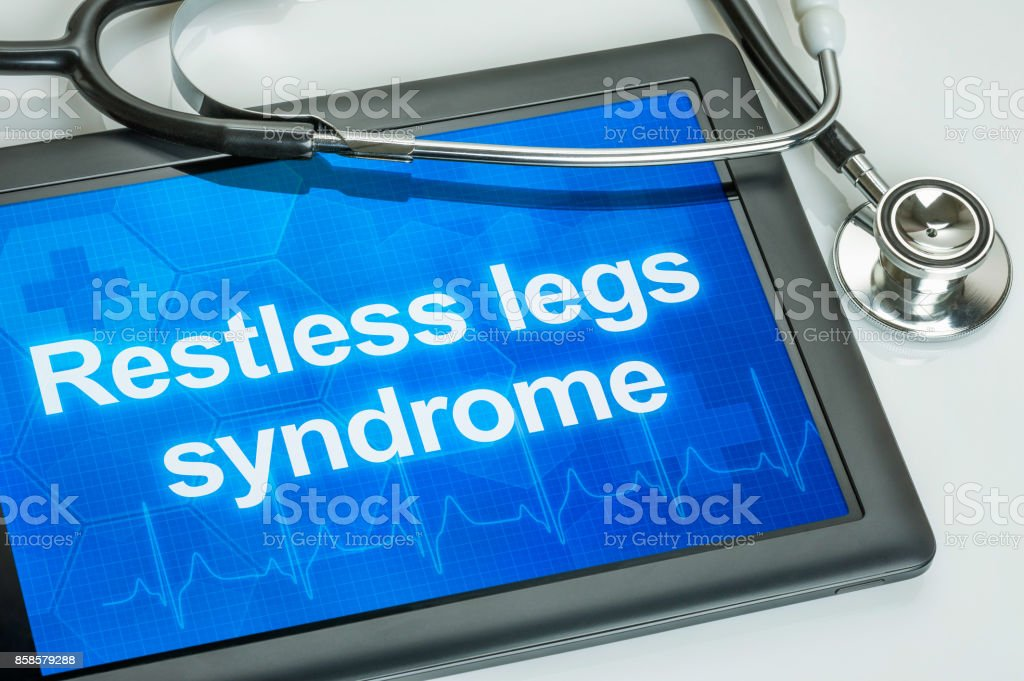 Tablet with the diagnosis Restless legs syndrome on the display stock photo