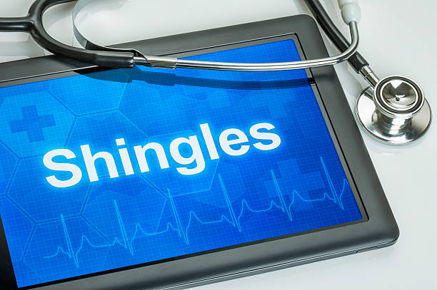 Tablet with the diagnosis Shingles on the display stock photo