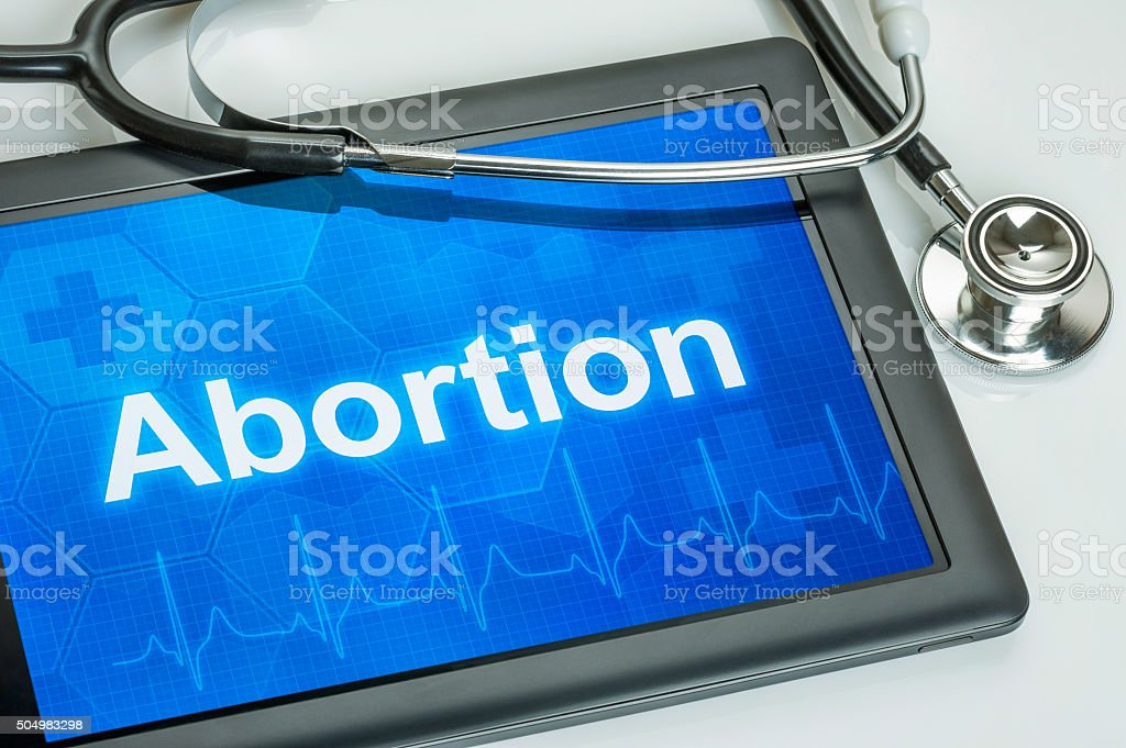 Tablet with the text Abortion on the display stock photo