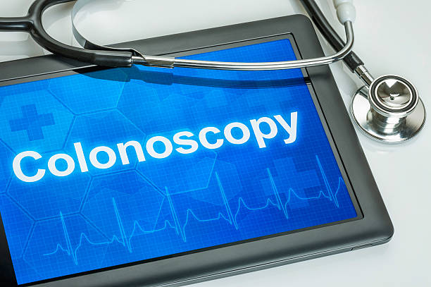 tablet with the text colonoscopy on the display - screening stock photos and pictures