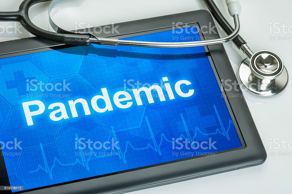 Tablet with the text Pandemic on the display stock photo